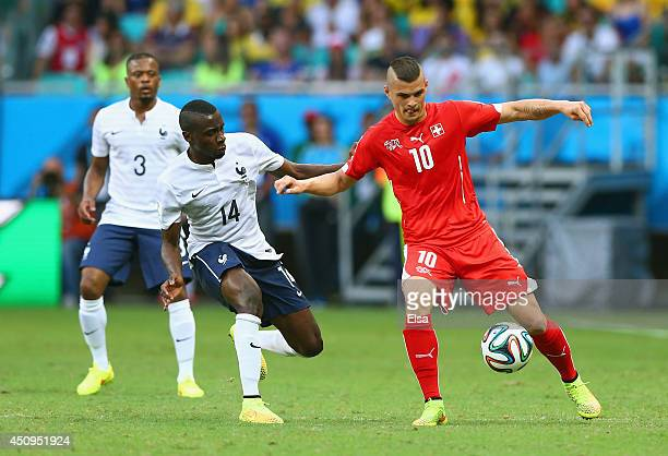 Granit Xhaka of Switzerland controls the ball as Blaise Matuidi of France gives chase during the 2014 FIFA World Cup Brazil Group E match between...