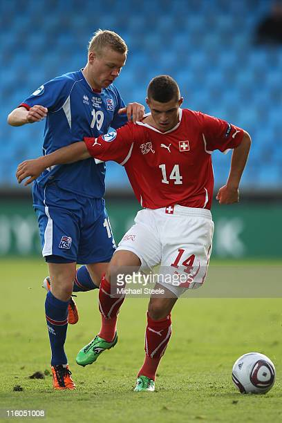 Granit Xhaka of Switzerland is challenged by Kolbeinn Sigthorsson during the UEFA European Under21 Championship Group A match between Switzerland and...