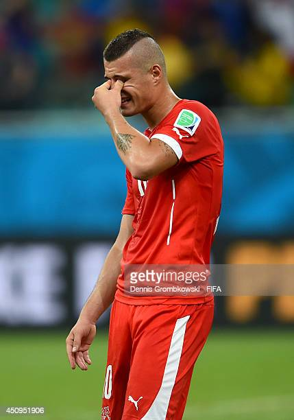 Granit Xhaka of Switzerland shows his dejection after 25 defeat in the 2014 FIFA World Cup Brazil Group E match between Switzerland and France at...
