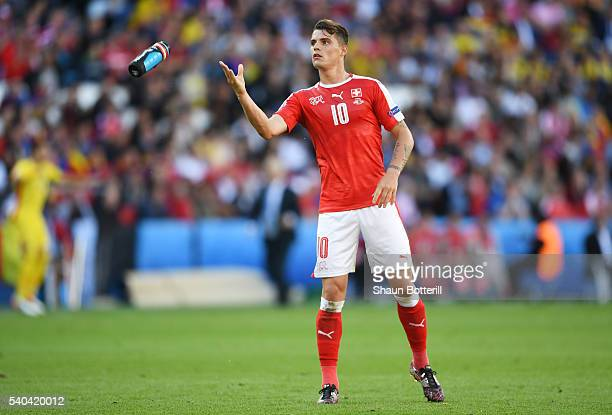 Granit Xhaka of Switzerland throws a drinks bottle to the bench during the UEFA EURO 2016 Group A match between Romania and Switzerland at Parc des...