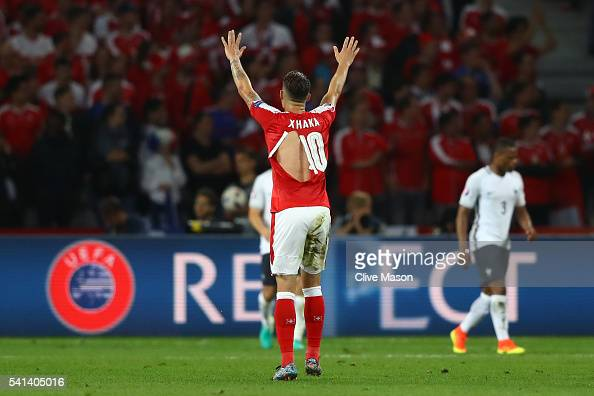 Granit Xhaka of Switzerland wears a ripped shirt during the UEFA EURO 2016 Group A match between Switzerland and France at Stade PierreMauroy on June...