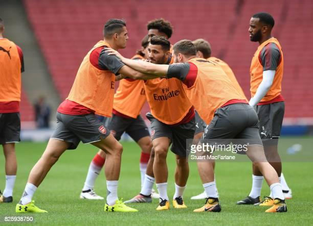Granit Xhaka Sead Kolasinac and Shkodran Mustafi of Arsenal during a training session at Emirates Stadium on August 3 2017 in London England