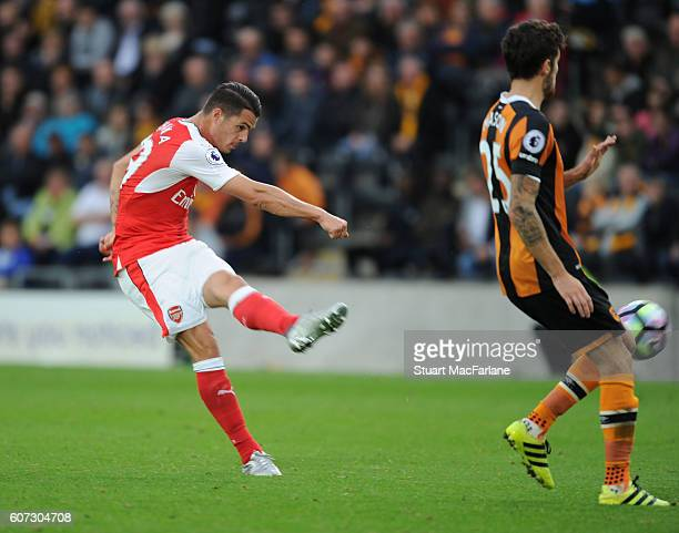 Granit Xhaka shoots past Hull's Ryan Mason to score the 4th Arsenal goal during the Premier League match between Hull City and Arsenal at KCOM...