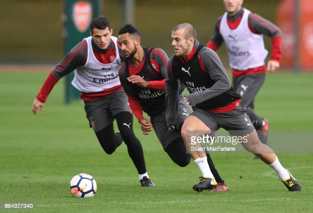 Granit Xhaka Theo Walcott and Jack Wilshere of Arsenal during a training session at London Colney on October 21 2017 in St Albans England
