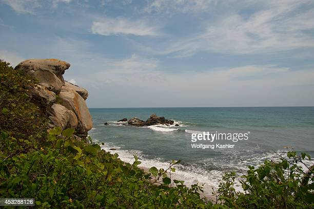 Granite rock formation along coastline at Tayrona National Park Santa Marta Colombia