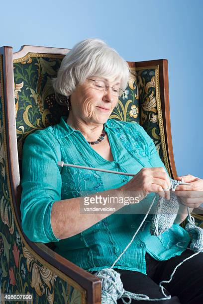 Grannie Knitting In Her Favourite Chair