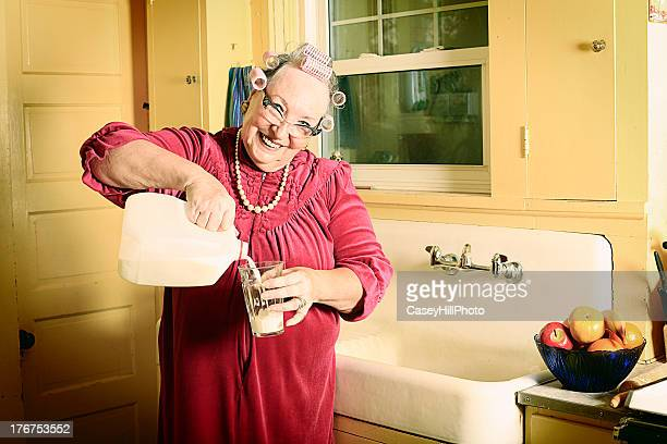 Granny in Kitchen Pouring Milk