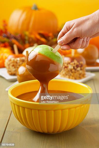Granny Smith Apple Dipping into Caramel