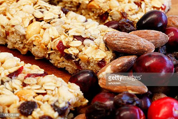 Granola Bars with Cranberries, Almonds and Raisins on Wood