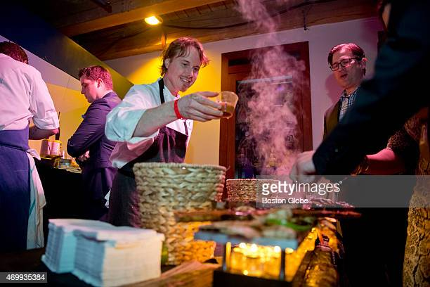 Grant Achatz one of the leaders in molecular gastronomy or progressive cuisine and chef at Alinea in Chicago pouring savory Caribbean spices on...