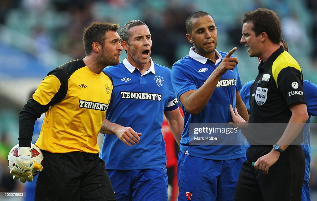 Grant Adam, David Weir and Madjid Boucherra of the Rovers make their point clear to the referee during the pre-season friendly match between Blackburn Rovers and Glasgow Rangers at the Sydney Football Stadium on July 25, 2010 in Sydney, Australia.