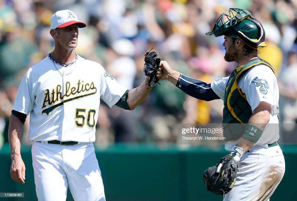 Grant Balfour #50 and Derek Norris #36 of the Oakland Athletics celebrate defeating the Chicago Cubs 1-0 at O.co Coliseum on July 4, 2013 in Oakland, California.