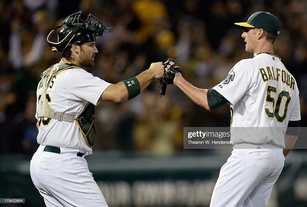 Grant Balfour #50 and Derek Norris #36 of the Oakland Athletics celebrate defeating the Boston Red Sox 3-0 at O.co Coliseum on July 13, 2013 in Oakland, California.