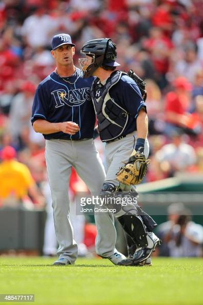Grant Balfour and Ryan Hanigan of the Tampa Bay Rays celebrate defeating the Cincinnati Reds at Great American Ball Park on Saturday April 12 2014 in...