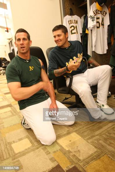 Grant Balfour and Travis Blackley of the Oakland Athletics chat in the clubhouse prior to the game against the New York Yankees at the OaklandAlameda...