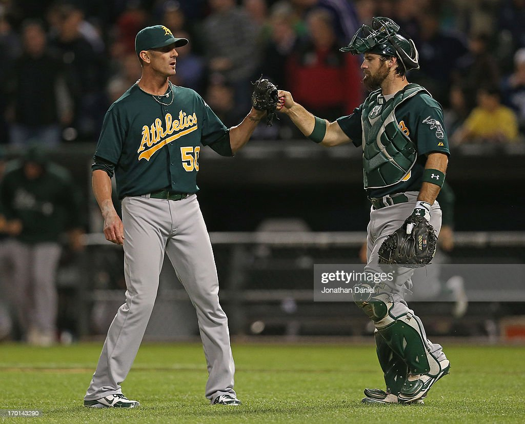 <a gi-track='captionPersonalityLinkClicked' href=/galleries/search?phrase=Grant+Balfour&family=editorial&specificpeople=833980 ng-click='$event.stopPropagation()'>Grant Balfour</a> #50 of the Oakland Athletics (L) celebrates a win against the Chicago White Sox with <a gi-track='captionPersonalityLinkClicked' href=/galleries/search?phrase=Derek+Norris&family=editorial&specificpeople=6795804 ng-click='$event.stopPropagation()'>Derek Norris</a> #36 at U.S. Cellular Field on June 7, 2013 in Chicago, Illinois. The Athletics defeated the White Sox 4-3.