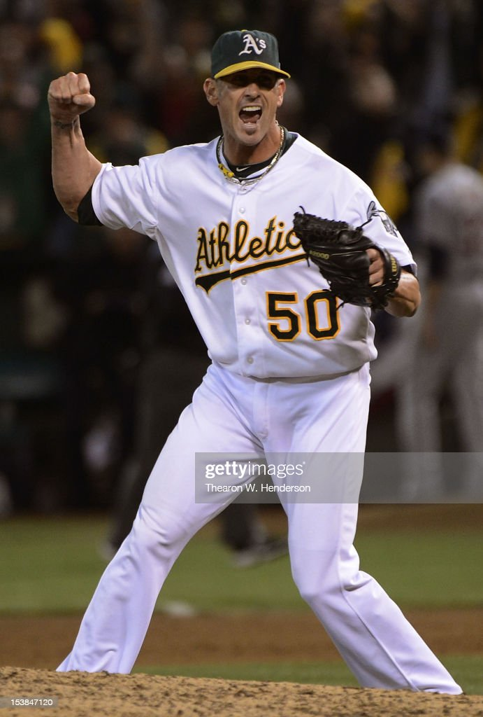 <a gi-track='captionPersonalityLinkClicked' href=/galleries/search?phrase=Grant+Balfour&family=editorial&specificpeople=833980 ng-click='$event.stopPropagation()'>Grant Balfour</a> #50 of the Oakland Athletics celebrates after the Athletics defeats the Detroit Tigers 2 to 0 in Game Three of the American League Division Series at Oakland-Alameda County Coliseum on October 9, 2012 in Oakland, California.