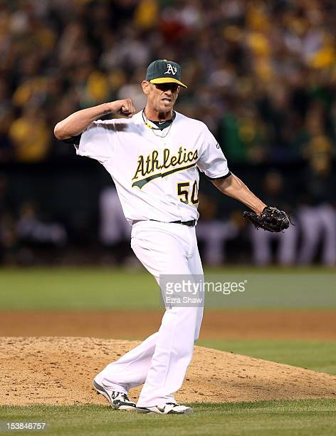 Grant Balfour of the Oakland Athletics celebrates after the last out of their game against the Detroit Tigers during Game Three of the American...