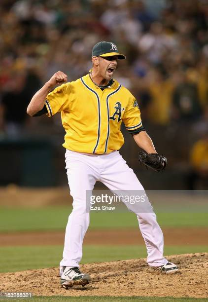 Grant Balfour of the Oakland Athletics celebrates after the Oakland Athletics beat the Texas Rangers at Oco Coliseum on October 2 2012 in Oakland...