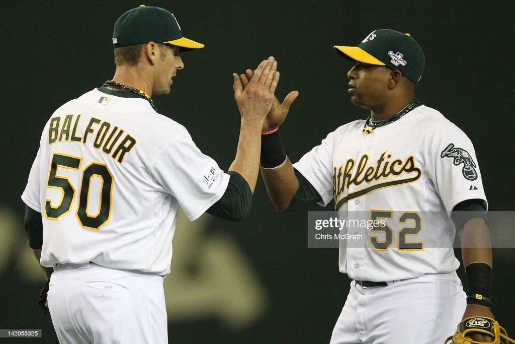 <a gi-track='captionPersonalityLinkClicked' href=/galleries/search?phrase=Grant+Balfour&family=editorial&specificpeople=833980 ng-click='$event.stopPropagation()'>Grant Balfour</a> #50 of the Oakland Athletics celebrates victory with team mate <a gi-track='captionPersonalityLinkClicked' href=/galleries/search?phrase=Yoenis+Cespedes&family=editorial&specificpeople=8892047 ng-click='$event.stopPropagation()'>Yoenis Cespedes</a> #52 during the MLB Opening Series game two between the Seattle Mariners and Oakland Athletics at Tokyo Dome on March 29, 2012 in Tokyo, Japan.