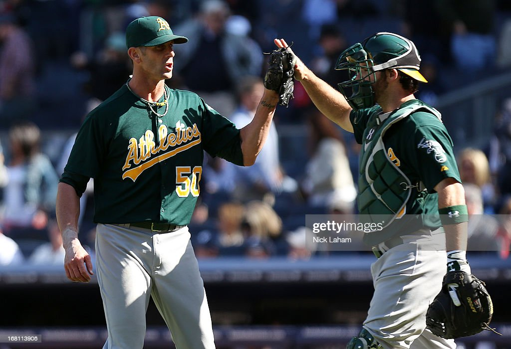 Grant Balfour #50 of the Oakland Athletics celebrates winning with catcher Derek Norris #36 against the New York Yankees at Yankee Stadium on May 5, 2013 in the Bronx borough of New York City.
