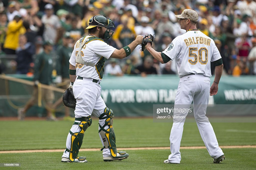 Grant Balfour #50 of the Oakland Athletics celebrates with Derek Norris #36 after the interleague game against the San Francisco Giants at O.co Coliseum on May 27, 2013 in Oakland, California. The Oakland Athletics defeated the San Francisco Giants 4-1.