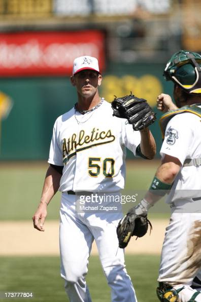 Grant Balfour of the Oakland Athletics celebrates with Derek Norris following the game against the Chicago Cubs at Oco Coliseum on July 4 2013 in...