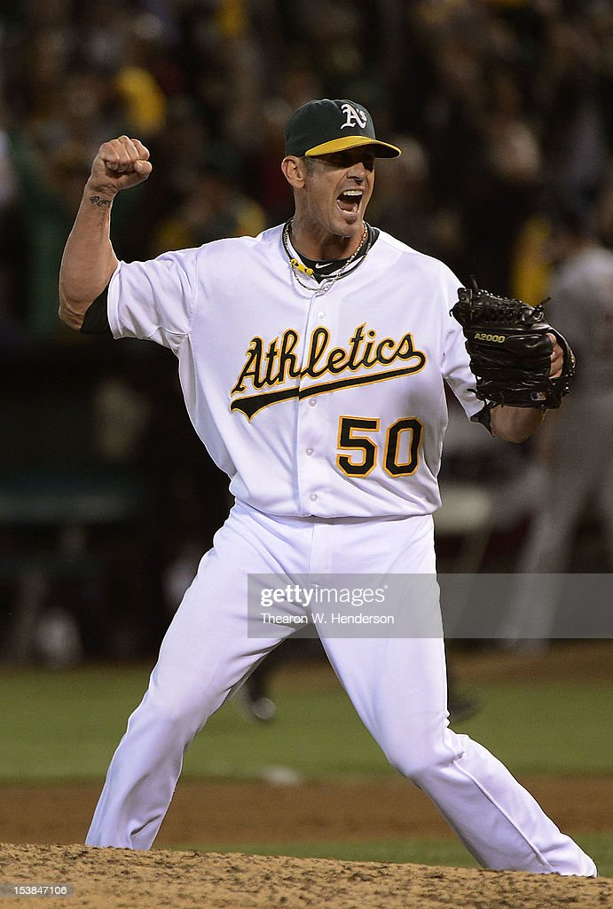 <a gi-track='captionPersonalityLinkClicked' href=/galleries/search?phrase=Grant+Balfour&family=editorial&specificpeople=833980 ng-click='$event.stopPropagation()'>Grant Balfour</a> #50 of the Oakland Athletics celebrats after the Athletics defeats the Detroit Tigers 2 to 0 during Game Three of the American League Division Series at Oakland-Alameda County Coliseum on October 9, 2012 in Oakland, California.