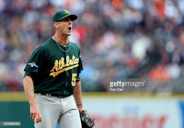 Grant Balfour of the Oakland Athletics exchanges words with Victor Martinez of the Detroit Tigers in the ninth inning during Game Three of the...