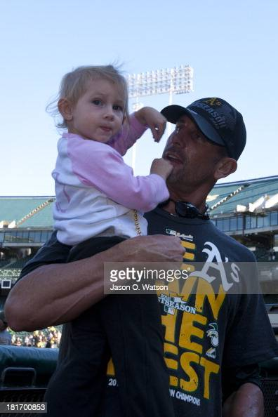 Grant Balfour of the Oakland Athletics holds his daughter on the field after the game against the Minnesota Twins at Oco Coliseum on September 22...