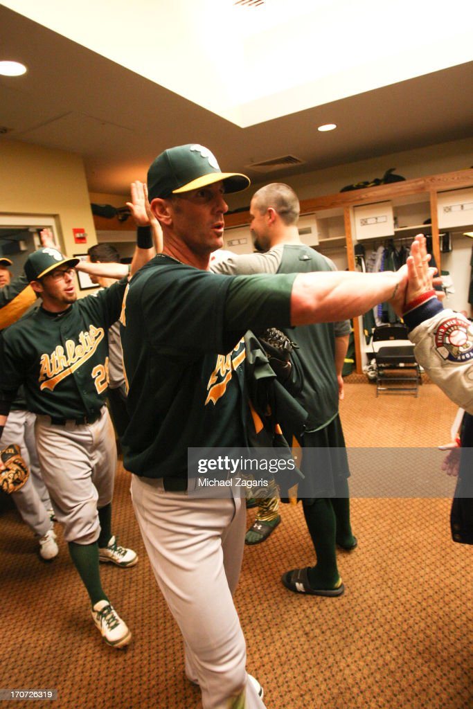Grant Balfour #50 of the Oakland Athletics is congratulated in the clubhouse following the game against the San Francisco Giants at AT&T Park on May 29, 2013 in San Francisco, California. The Athletics defeated the Giants 9-6.
