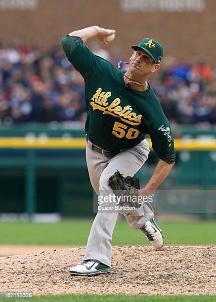 Grant Balfour of the Oakland Athletics pitches against the Detroit Tigers in the ninth inning during Game Three of the American League Division...