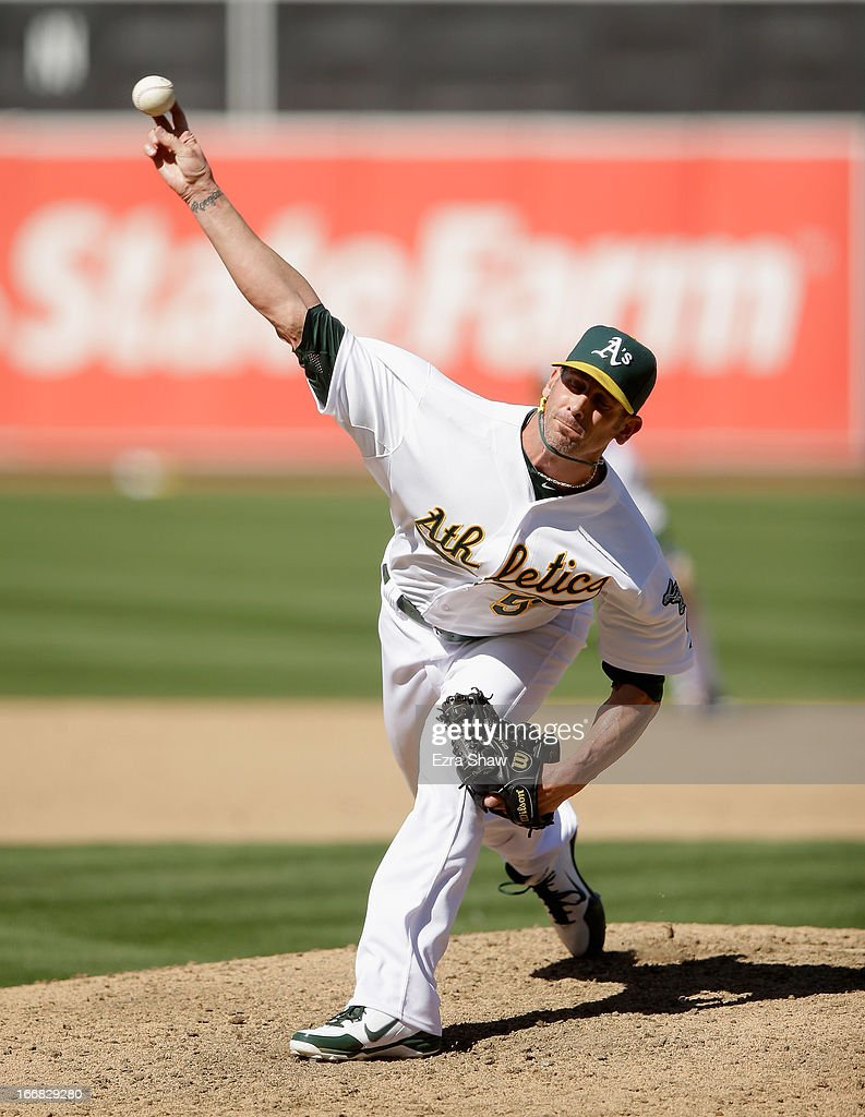 Grant Balfour #50 of the Oakland Athletics pitches against the Houston Astros at O.co Coliseum on April 17, 2013 in Oakland, California.