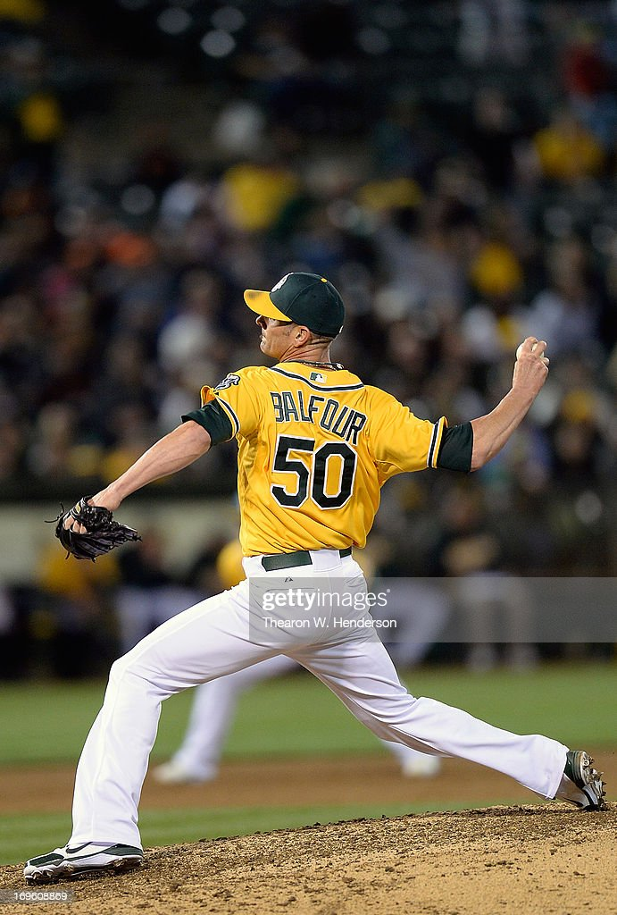 Grant Balfour #50 of the Oakland Athletics pitches against the San Francisco Giants in the ninth inning at O.co Coliseum on May 28, 2013 in Oakland, California.