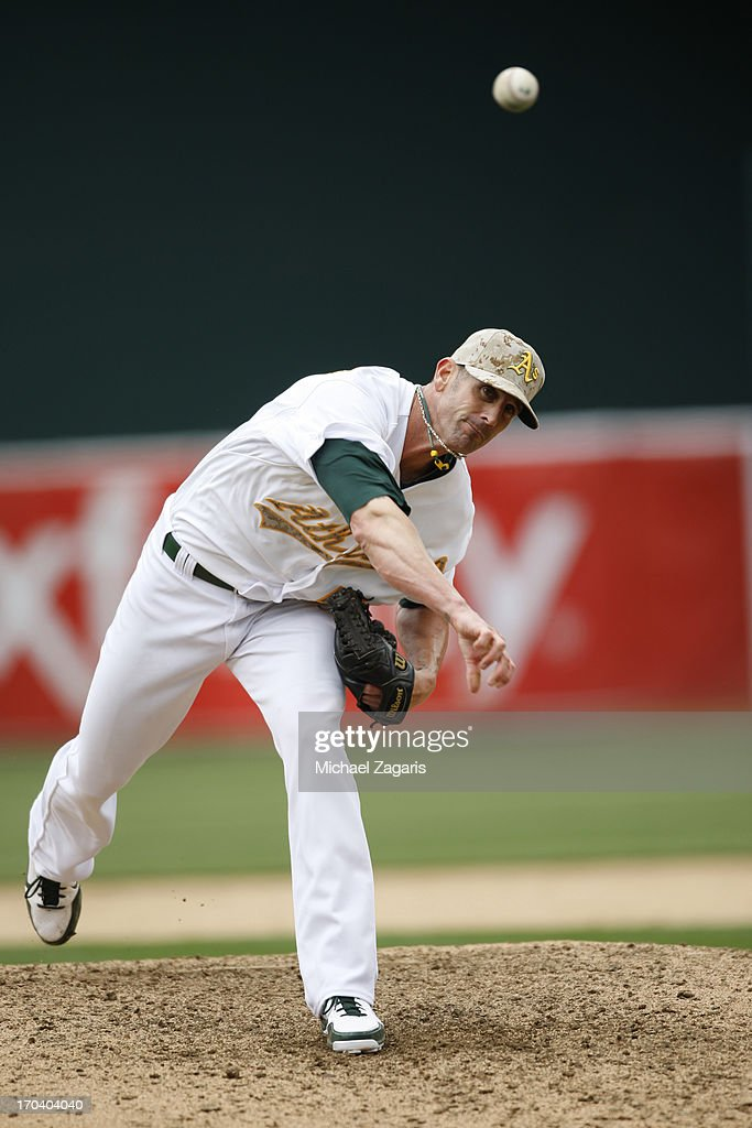 Grant Balfour #50 of the Oakland Athletics pitches during the game against the San Francisco Giants at O.co Coliseum on May 27, 2013 in Oakland, California. The Athletics defeated the Giants 4-1.