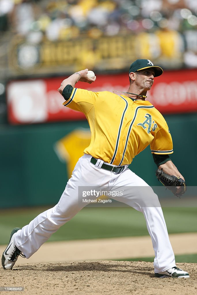 Grant Balfour #50 of the Oakland Athletics pitches during the game against the Chicago White Sox at O.co Coliseum on June 1, 2013 in Oakland, California. The Athletics defeated the White Sox 4-3.