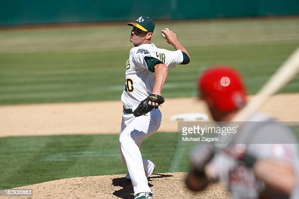 Grant Balfour of the Oakland Athletics pitches during the game against the Los Angeles Angels of Anaheim at Oco Coliseum on September 18 2013 in...