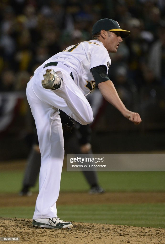 <a gi-track='captionPersonalityLinkClicked' href=/galleries/search?phrase=Grant+Balfour&family=editorial&specificpeople=833980 ng-click='$event.stopPropagation()'>Grant Balfour</a> #50 of the Oakland Athletics pitches in the ninth inning against the Detroit Tigers during Game Three of the American League Division Series at Oakland-Alameda County Coliseum on October 9, 2012 in Oakland, California. The Athletics won the game 2-0.