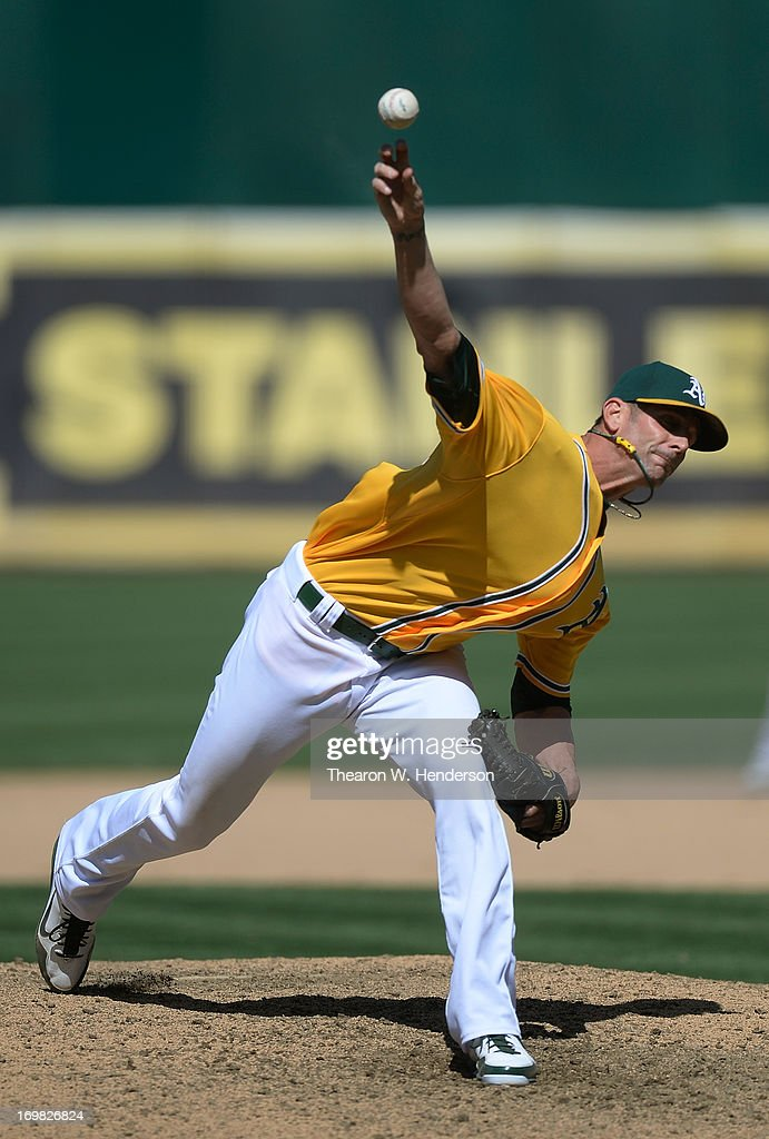 <a gi-track='captionPersonalityLinkClicked' href=/galleries/search?phrase=Grant+Balfour&family=editorial&specificpeople=833980 ng-click='$event.stopPropagation()'>Grant Balfour</a> #50 of the Oakland Athletics pitches in the ninth inning against the Chicago White Sox at O.co Coliseum on June 2, 2013 in Oakland, California. The Athletics defeated the White Sox 2-0.
