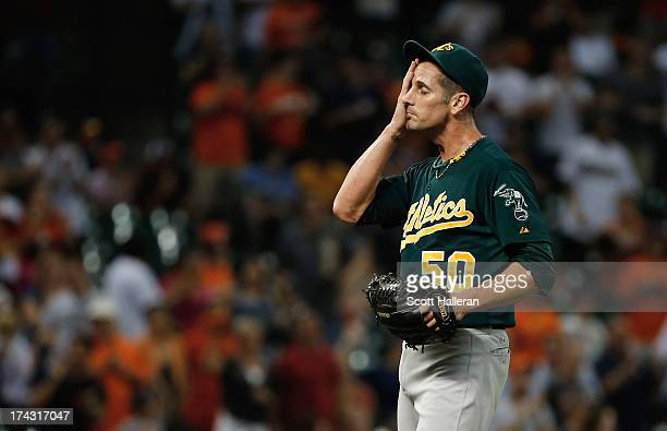 Grant Balfour of the Oakland Athletics reacts to allowing a hit in the ninth inning against the Houston Astros at Minute Maid Park on July 23 2013 in...