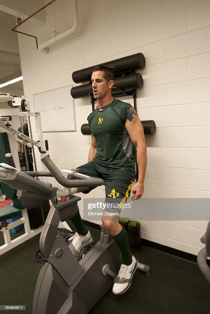 Grant Balfour #50 of the Oakland Athletics rides a bike in the clubhouse at Phoenix Municipal Stadium on February 23, 2013 in Phoenix, Arizona.
