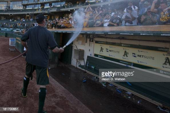 Grant Balfour of the Oakland Athletics sprays fans with a water hose after the game against the Minnesota Twins at Oco Coliseum on September 22 2013...