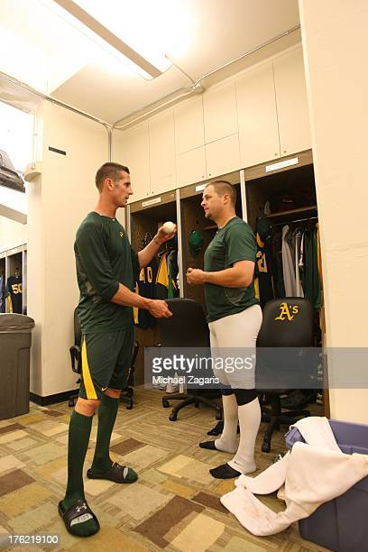 Grant Balfour of the Oakland Athletics talks with Stephen Vogt in the clubhouse following the game against the Los Angeles Angels of Anaheim at Oco...