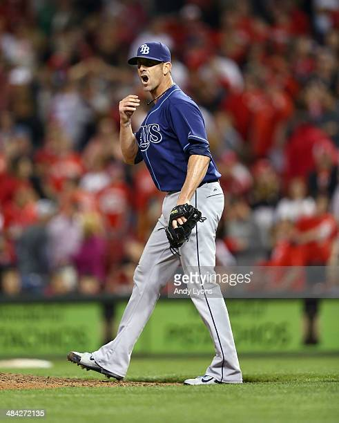 Grant Balfour of the Tampa Bay Rays celebrates after the final out of the 21 win over the Cincinnati Reds at Great American Ball Park on April 11...