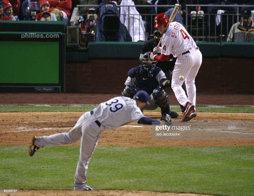 Grant Balfour #50 of the Tampa Bay Rays hits Eric Bruntlett #4 of the Philadelphia Phillies with a pitch during game three of the 2008 MLB World Series on October 25, 2008 at Citizens Bank Park in Philadelphia, Pennsylvania.