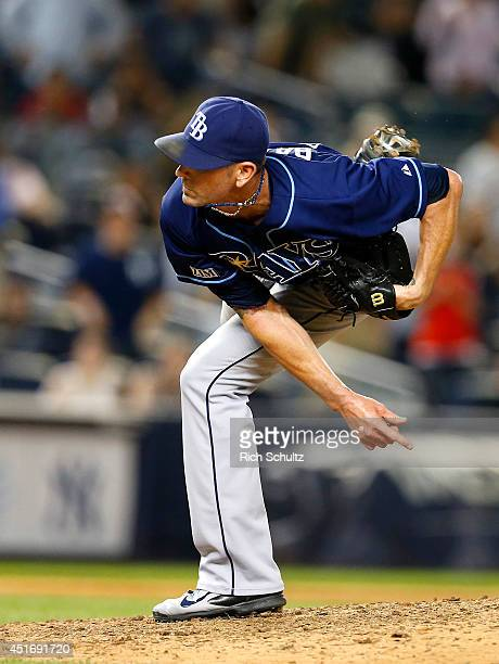 Grant Balfour of the Tampa Bay Rays on the mound against the New York Yankees in a MLB baseball game at Yankee Stadium on July 1 2014 in the Bronx...