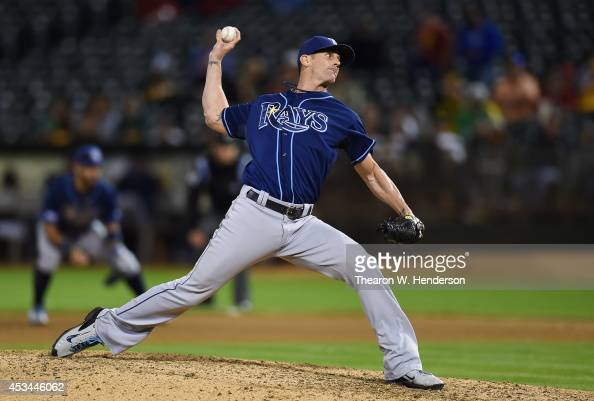 Grant Balfour of the Tampa Bay Rays pitches against the Oakland Athletics in the bottom of the tenth inning at Oco Coliseum on August 4 2014 in...
