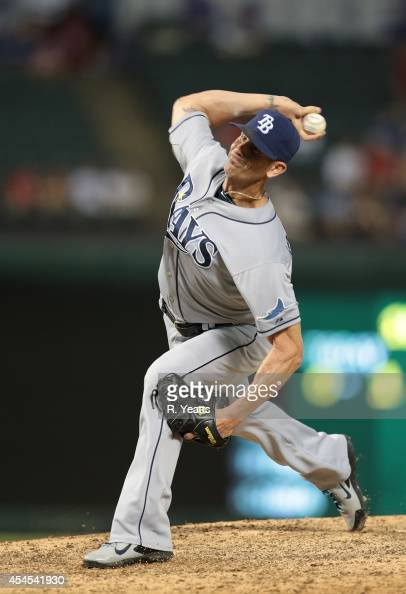 Grant Balfour of the Tampa Bay Rays throws in the twelfth inning against the Texas Rangers at Globe Life Park in Arlington on August 12 2014 in...