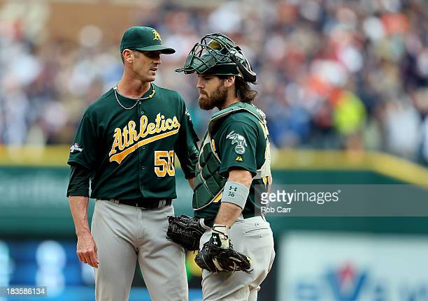Grant Balfour speaks with Derek Norris of the Oakland Athletics in the ninth inning during Game Three of the American League Division Series against...