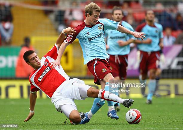 Grant Basey of Charlton tackles Wade Elliott of Burnley during the Coca Cola Championship match between Charlton Athletic and Burnley at The Valley...